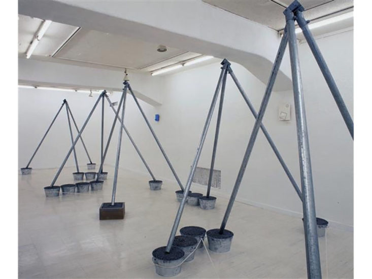 Suga Kishio, The Cultivation of Mother Earth (2000), Steel pipes, buckets, wooden box, macadam, rope, 310 x 936 x (h) 228 cm  Photo by Tsuyoshi Satoh